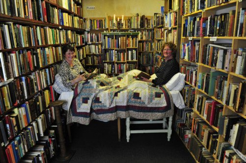 Nicky McDonald, manager of the Book Shop in Wigtown, with owner Shaun Bythell in the festival's bookshop bed. Picture: Robert Perry